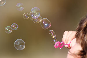 Soap bubble - Woman blowing bubbles.