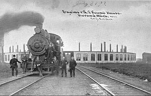Grand Trunk Western Railroad - A 1909 photograph of a Grand Trunk Western locomotive and crew at the Durand, Michigan roundhouse