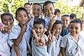Group photograph of school children smiling in Laos.jpg