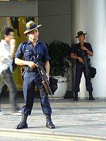 A Gurkha Contingent trooper in Singapore armed with a folding stock pump shotgun