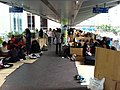 HK Central footbridge Sunday holiday visitors Fibra paper booths Winter wind Dec-2012.JPG