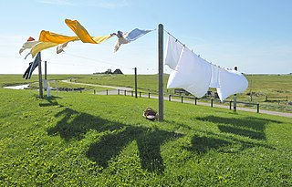 Clothes line rope stretched between two points in order to hang and dry laundry
