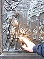 Hand-polished relief of man and dog at base of St. John of Nepomuk statue, Charles Bridge.JPG