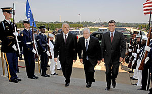 Secretary of Defense Robert M. Gates (center) ...