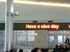 "Frederic Schwartz - The message board at the Whitehall Terminal, showing the message, ""Have a nice day."""