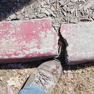 Hayward Fault Zone - The effects of 15 years of fault creep on a curb in Fremont.