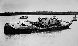 HMAS Arrow (P 88) - HMAS Arrow in beached Francis Bay Feb–March 1975