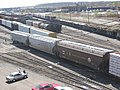 Hopper cars in a railyard.jpg