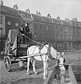 Horse-drawn delivery van of the London, Midland and Scottish railway halted in a sqaure in Bloomsbury during 1943 to allow the horse to get a drink. D16833.jpg