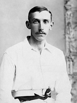 A head and shoulders portrait photograph of Truble wearing cricket whites