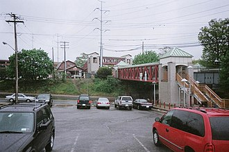 New York State Route 110 - NY 110 as seen from the parking lot of the Huntington LIRR station. Pedestrian bridges crossing the roadway connect both of the station's parking lots