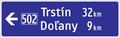 IS 18a - Smerová tabuľa s dvoma cieľmi (vľavo).png