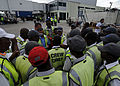 In preparation for the first commercial airlines to resume flights into Haiti's International Airport, ground crew and baggage workers gather together to make sure things are ready for their flights to land 100219-N-HX866-007.jpg