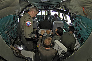 Ilyushin Il-76 - USAF and IAF airmen work inside the cockpit of an Indian Il-76.