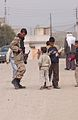 Iraqi soldier talks with children in Mosul DVIDS40275.jpg