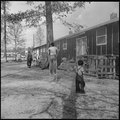 Jerome Relocation Center, Denson, Arkansas. A street scene in block 7 on a November afternoon. - NARA - 538833.tif