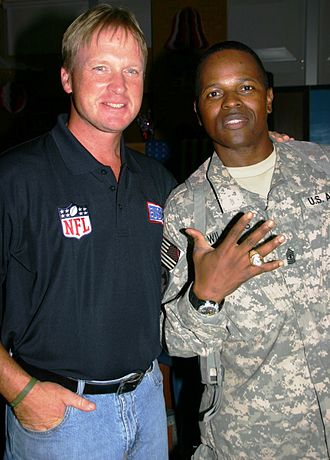 Jon Gruden - Gruden visited U.S. troops in Iraq during a USO tour in July 2009, where he allowed a serviceman to wear his Super Bowl ring.
