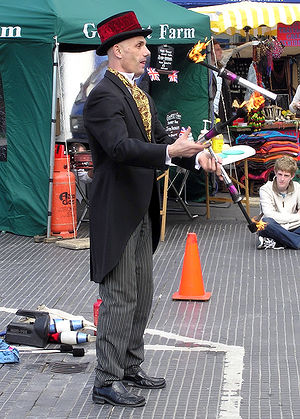 A street performer juggling torches in Devizes...