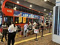 KMB staff in Tuen Mun Station help passengers to take Route 56S 10-10-2020(3).jpg