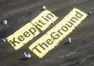 Fossil fuel divestment - 'Keep it in the ground' banner spread out by environmental activists in a coal mine