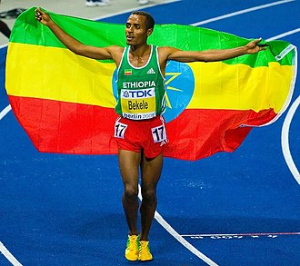 10,000 metres world record progression - Current men's world record holder Kenenisa Bekele celebrating his 2009 world title in the 10,000 m