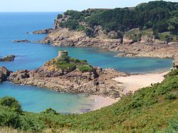 St. Brelade's coastline of promontories and bays includes Portelet and its tidal island, L'Île au Guerdain with Portelet Tower (also known as Janvrin's Tomb)