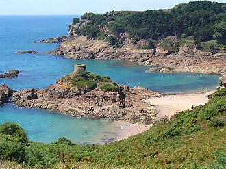 Saint Brélade - St. Brelade's coastline of promontories and bays includes Portelet and its tidal island, L'Île au Guerdain with Portelet Tower (also known as Janvrin's Tomb)