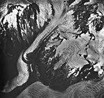 La Perouse Glacier, mountain glacier joining lobe of tidewater glacier, August 24, 1963 (GLACIERS 5547).jpg