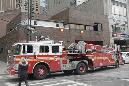 A tiller or tractor-drawn aerial ladder is another type of Ladder Truck operated by the FDNY. Pictured is a tiller ladder truck operated by Ladder Co. 5, quartered in Manhattan. Ladder 5 FDNY on 8th Av 48th St jeh.jpg