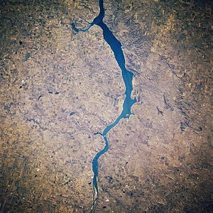 Oahe Dam - Upper Lake Oahe (Reservoir), between Cannon Ball, North Dakota, and Pollock, South Dakota, as seen from space, October 1985. South is at the top of the photo.