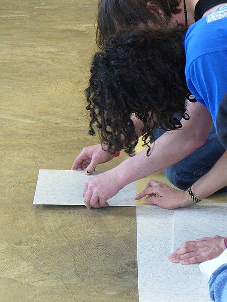 File:Laying tiles at OCP.JPG