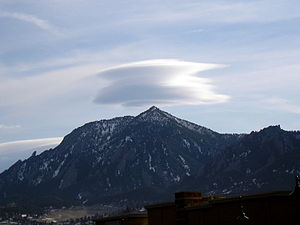 Lenticular cloud above the Flatirons. Boulder,...