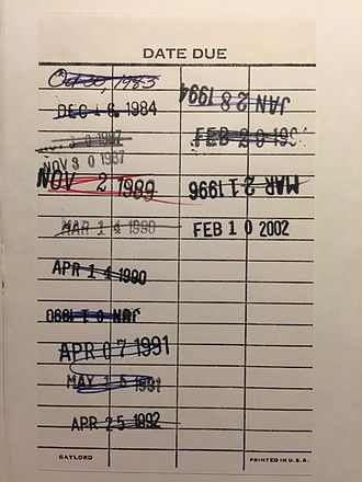 Library circulation - A date due slip showing checkout and return activity from 1983 to 1996