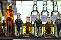 Line up of snake and scorpion whisky bottles (14418472550).jpg