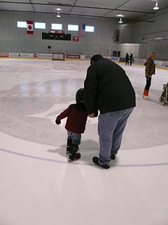 Little boy learning to skate