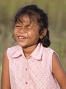 Little girl winking in the sunshine in Laos.jpg