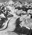 Lituya Glacier, tidewater glacier with medial moraines and hanging glaciers on the mountainside, August 16, 1961 (GLACIERS 5593).jpg