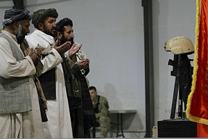 Coalition casualties in Afghanistan - Local Afghans pay respect during the memorial service in honor of Albanian Army Capt. Feti Vogli