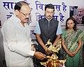 """M. Venkaiah Naidu lighting the lamp to inaugurate the """"Saath Hai Vishwaas Hai, Ho Raha Vikas Hai"""" Exhibition of DAVP, at Sarojini Nagar, in New Delhi.jpg"""