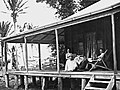 Man and woman relaxing on the verandah of their farmhouse, 1911 (8758691541).jpg