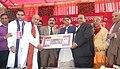 Manish Tewari being honoured by the Management Committee of Jagannath Rath Yatra, at Ludhiana on December 15, 2013. The Joint Editor of Punjab Kesari Group, Shri Avinash Chopra and the MLA, Shri Surinder Dabar are also seen.jpg