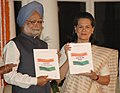 Manmohan Singh releasing 'Report to the People 2004-07' and giving a copy to the Chairperson, UPA, Smt. Sonia Gandhi on the occasion of Third anniversary of the UPA Government, in New Delhi on May 22, 2007 (1).jpg