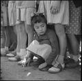 Manzanar Relocation Center, Manzanar, California. A little girl evacuee of Japanese descent watches . . . - NARA - 538550.tif