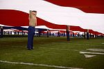 Marines stand together to unfurl Old Glory at 38th annual Holiday Bowl 151230-M-HF454-006.jpg