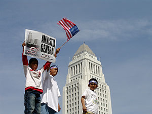 Kids hold signs in front of Los Angeles City H...