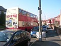 Mayne and Son bus in Manchester with rear advert.jpg