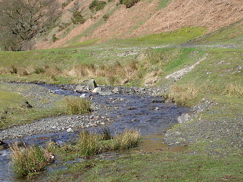 figure 104 this stream has deposited larger materials like gravel and pebbles along the inside curve of a meander