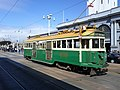 Melbourne streetcar 496 at the Ferry Building, March 2012.jpg