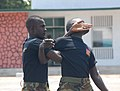 Members of the Ghana Army 2nd Engineer Battalion practice mechanical advantage control hold techniques during a nonlethal training demonstration June 26, 2013, in Accra, Ghana, as part of exercise Western Accord 130626-A-ZZ999-008.jpg