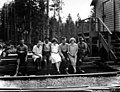 Men and women sitting on lumber pile, Northwest Door Company, Oregon, ca 1914 (KINSEY 2453).jpeg